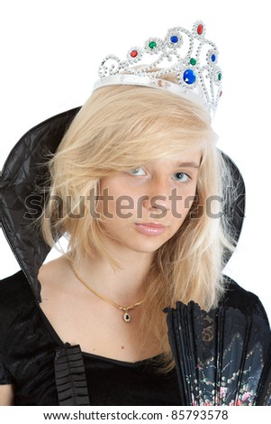 close-up portrait of teenager princess girl in black velvet dress and crown