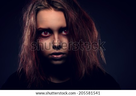 Close up portrait of teenager witch possessed by a demon - stock photo