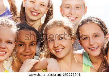 Close-up portrait of teenagers diversity in hug - stock photo