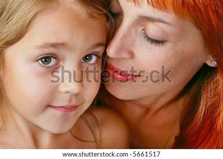 Close-up portrait of tender mother with beautiful little daughter