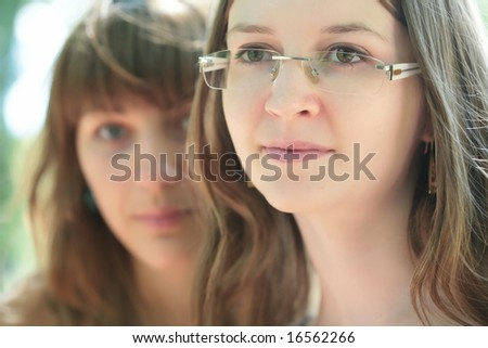 close-up portrait of the two young and beautiful girls