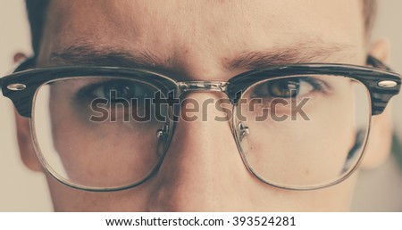 Close-up portrait of the young man in glasses - stock photo