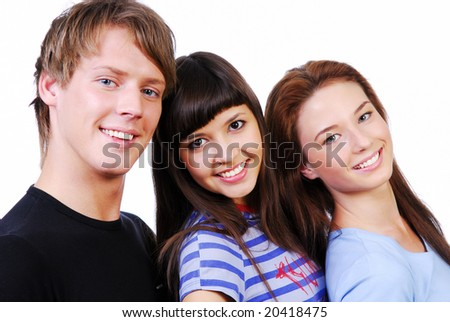 Close-up portrait of three beautiful students. Studio shot on white