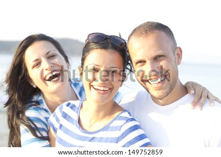 Close up portrait of three happy friends on their vacation - stock photo
