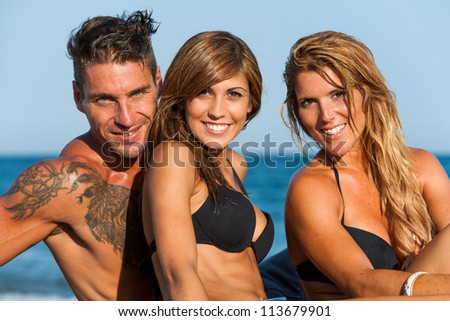 Close up portrait of Three young friends on beach.