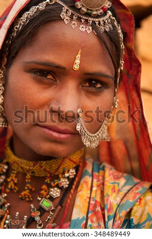 Close up portrait of traditional Indian woman in sari dress, India people.