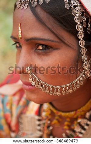 Close up portrait of traditional Indian woman in sari dress, with sad emotion, India people.