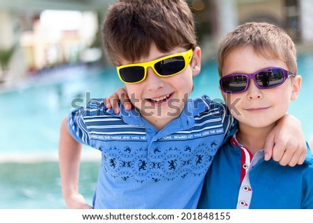 Close-up portrait of two boys - stock photo