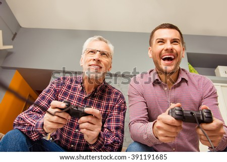 Close up portrait of two  handsome men playing video game - stock photo