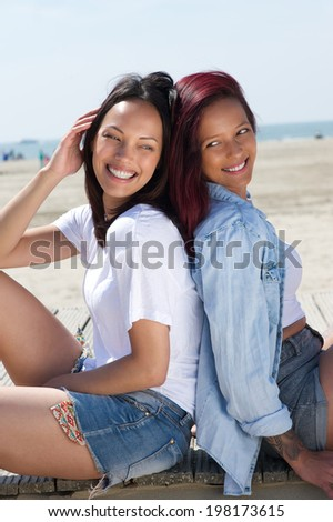 Close up portrait of two sisters smiling together outdoors