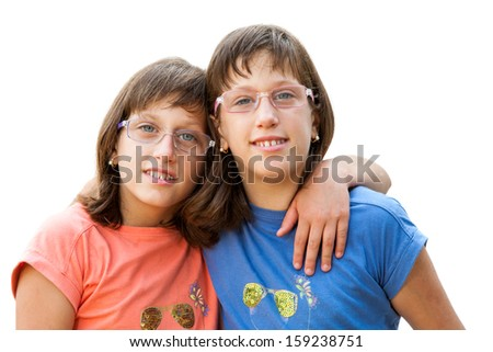 Close up portrait of two young handicapped twin sisters.Isolated on white background. - stock photo