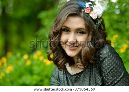 Close-up portrait of very beautiful,attractive,cute,excellent,smiling,lovely,adorable girl,woman with cute,nice,white,healthy smile in spring green park.White,healthy smile.Cute smile.Beautiful smile. - stock photo
