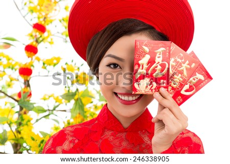Close-up portrait of Vietnamese young woman holding Tet greeting cards - stock photo