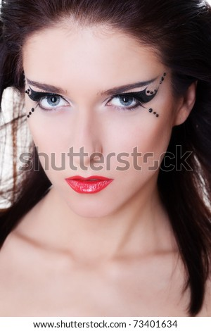 Close-up portrait of woman face with bright makeup - stock photo