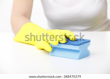 Close-up portrait of woman hand cleaning table. Isolated on white background.