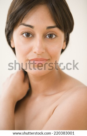 Close up portrait of woman holding hair