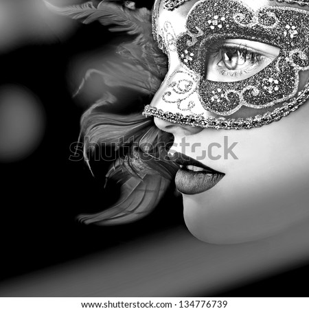 Close up portrait of woman in mask - stock photo