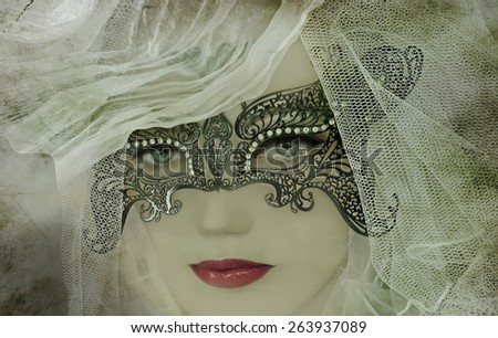 Close up portrait of woman in mysterious venetian mask - stock photo