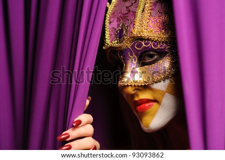 close up portrait of woman in violet mask - stock photo