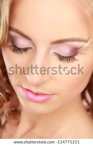 Close-up portrait of woman, isolated on pink background - stock photo