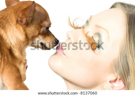 close-up portrait of woman, kissing her pet - stock photo