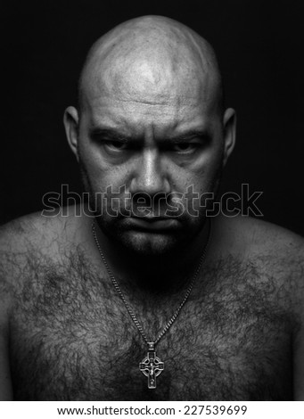 close up portrait of worrying bold man - stock photo
