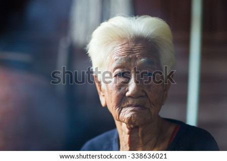 Close up portrait of 90 years old Thai woman