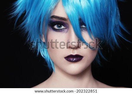 Close-up portrait of yound beautiful woman in blue cosplay wig