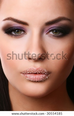 close-up portrait of  young adult with beautiful make-up - stock photo