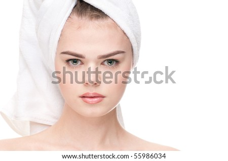 Close-up portrait of young adult woman with perfect health skin of face. Isolated on white.