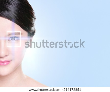Close up portrait of young and beautiful woman eye with the virtual hologram on her eyes, laser medicine and security technology concept, asian - stock photo