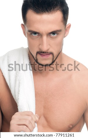 Close up portrait of young angry man face with perfect skin and towel. Isolated on white - stock photo