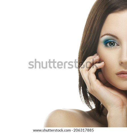 Close-up portrait of young appealing dark-haired woman against white background. - stock photo
