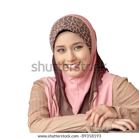 Close-up portrait of young Asian Muslim girl smiles with isolated background