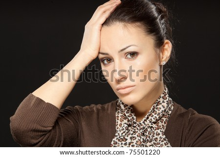 Close-up portrait of young attractive business woman having headache