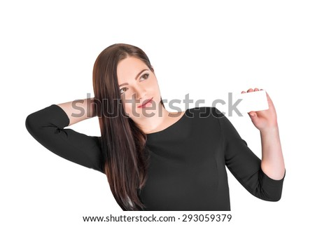 Close-up portrait of young attractive business woman holding white credit card isolated on white background
