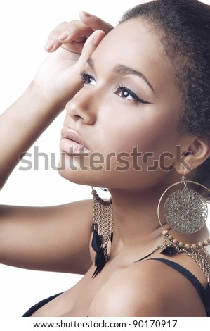 Close-up portrait of young beautiful african woman on white background - stock photo