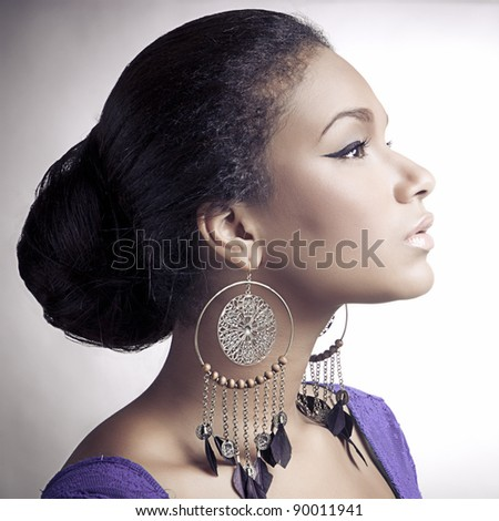 Close-up portrait of young beautiful african woman; square - stock photo