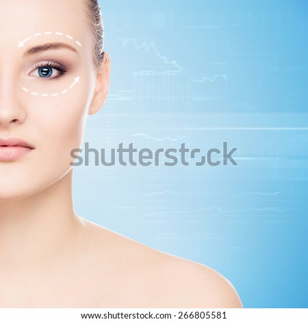 Close-up portrait of young, beautiful and healthy woman with arrows on her face.  - stock photo