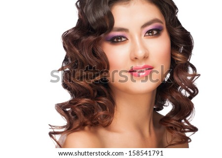 Close-up portrait of young beautiful asian woman with stylish violet make-up and hairstyle. Isolated on white background
