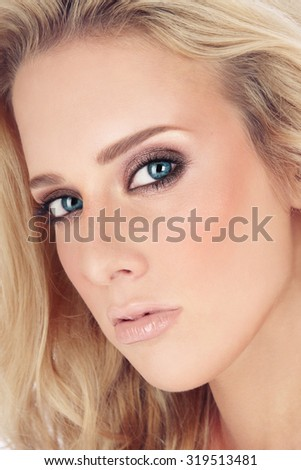 Close-up portrait of young beautiful blond girl with smoky eyes  - stock photo