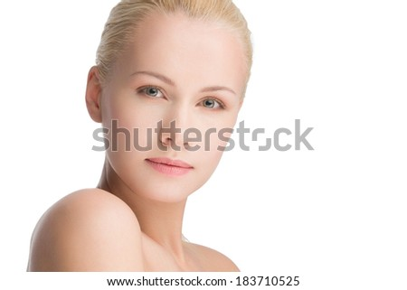 close-up portrait of young beautiful blond posing, natural make-up, space for copy - stock photo