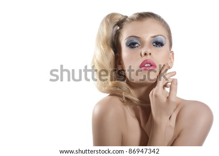Close-up portrait of young beautiful blond woman with hair tail stylish and creative make up posing and looking towards the camera against white background - stock photo