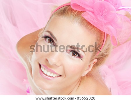 Close-up portrait of young beautiful fresh girl with pink make-up - stock photo