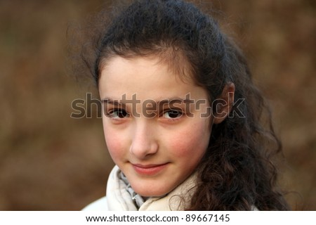 Close-up portrait of young beautiful girl - stock photo