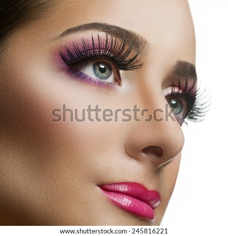 Close-up portrait of young beautiful girl with cat eye make-up - stock photo