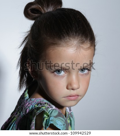 close up portrait of young beautiful little girl with dark hair - stock photo