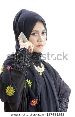 close up portrait of Young beautiful Muslim business woman while calling isolated over white background  - stock photo