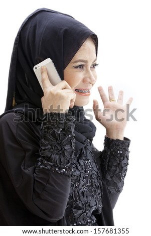 close up portrait of Young beautiful Muslim business woman while calling isolated over white background