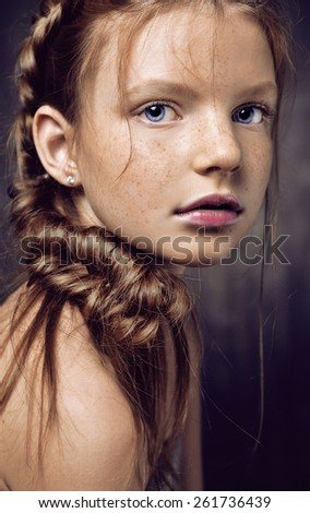 Close up portrait of young beautiful pretty cute teenage girl. Emotive portrait of a beautiful teen girl with healthy glossy hair. Close up. Studio shot - stock photo